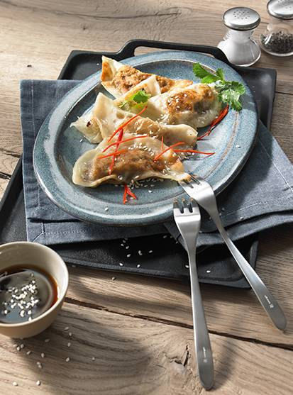 Gyoza with mushroom filling - steamed and fried Japanese dumplings with a mushroom filling and ponzu sauce