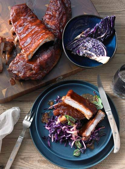 Sticky BBQ spare ribs on grilled red cabbage coleslaw