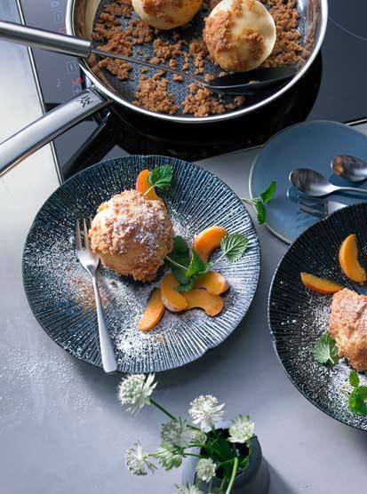 Potato quark dumplings with tipsy apricot in cinnamon crumbs