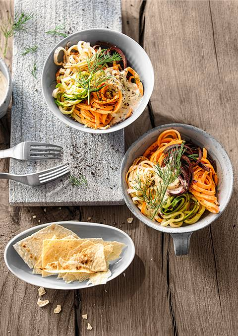 Colourful vegetable linguine salad with creamy cashew dressing